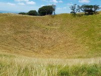 The crater of Mt Eden Maungawhau. There is a trapdoor at the bottom leading to hell. (#fakenews)